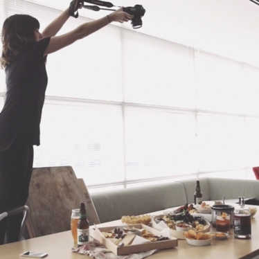 Behind the scenes of a cheese board photo shoot