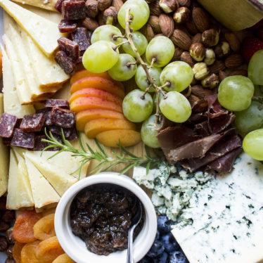 Cheese board with fruit and nuts